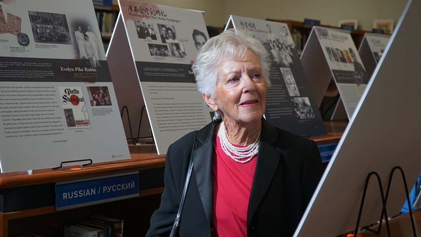 "Betty Grebenschikoff visits the ""Jewish Refugees in Shanghai"" exhibition in Brooklyn, 2019. Courtesy of the museum"