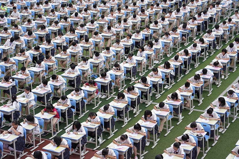 Over 6,000 students at Dongguan Nancheng Donghui Experimental School attend a handwriting competition in Dongguan, Guangdong province, May 17, 2019. An Dong/VCG