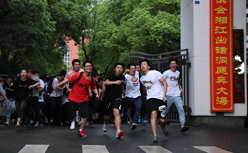 "Students rush out of their examination rooms after finishing the ""gaokao,"" China's grueling college entrance exams, in Changsha, Hunan province, June 8, 2019. Xue Yuge/Xinhua"