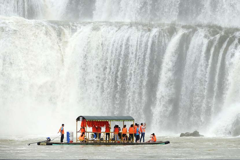 Tourists visit Detian Waterfall in Daxin County, Guangxi Zhuang Autonomous Region, June 11, 2019. Yu Xiangqian/Xinhua