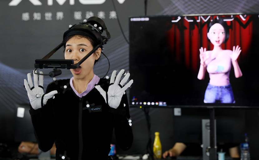 A staff member demonstrates a gesture-capturing system during the 2019 Consumer Electronics Show Asia in Shanghai, June 11, 2019. The three-day exhibition showcased the latest achievements in 5G technology, artificial intelligence, augmented and virtual reality, and vehicle technology. Fang Zhe/Xinhua