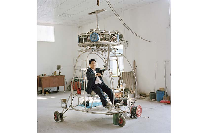 "Zhang Dousan sits in the helicopter he built, ""Dousan No. 5,"" in Chaozhou, Guangdong province, 2015. From ""Aeronautics in the Backyard"""
