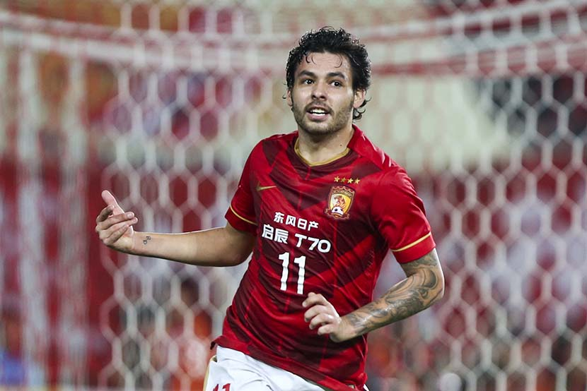 Brazilian soccer player Ricardo Goulart celebrates after scoring a goal during an AFC Champions League match in Guangzhou, Guangdong province, March 18, 2015. VCG