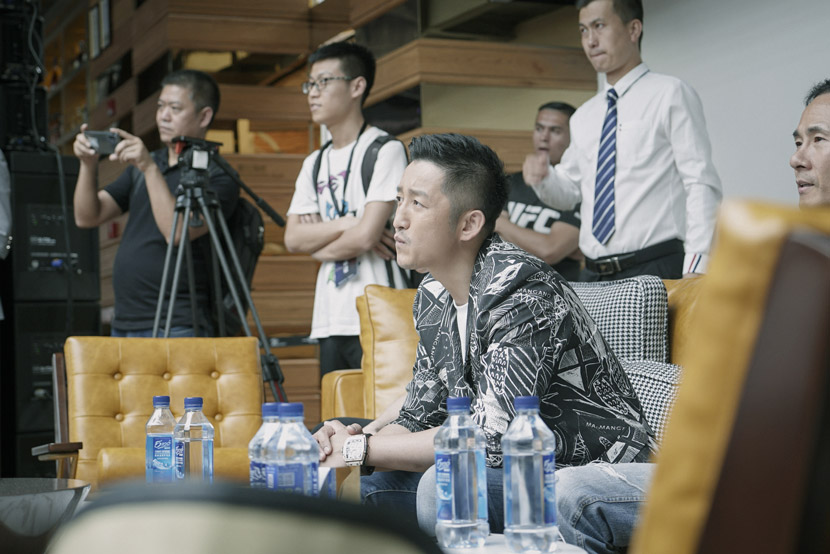 Zou Shiming watches the children's boxing match in Shanghai, June 1, 2019. Ding Yining/Sixth Tone