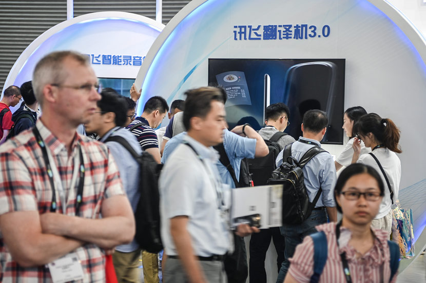 An iFlytek booth during a CES ASIA event in Shanghai, June 12, 2019. Gao Yuwen/VCG