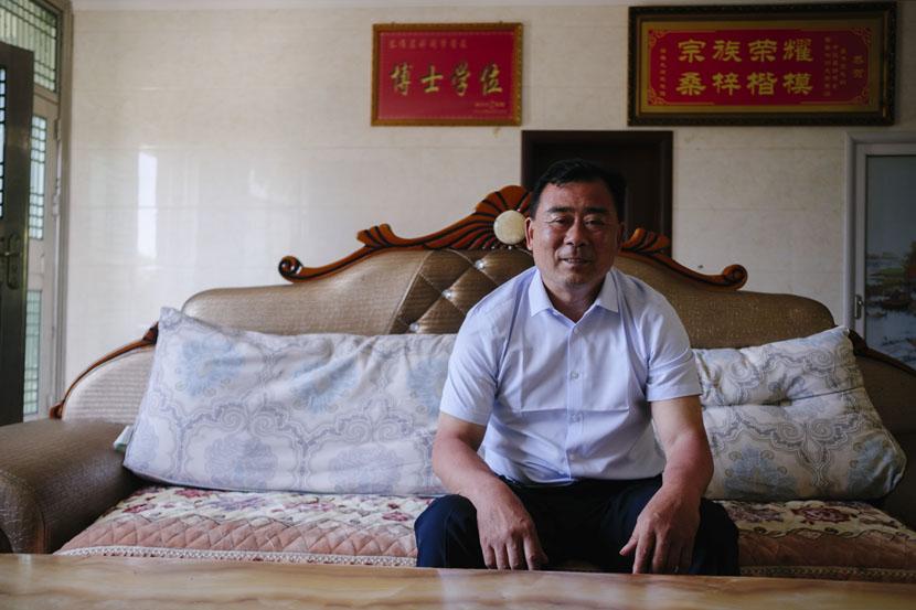 Qu Weiyuan poses for a photo at his house in Yangtian Village, Hunan province, June 4, 2019. Wu Huiyuan/Sixth Tone