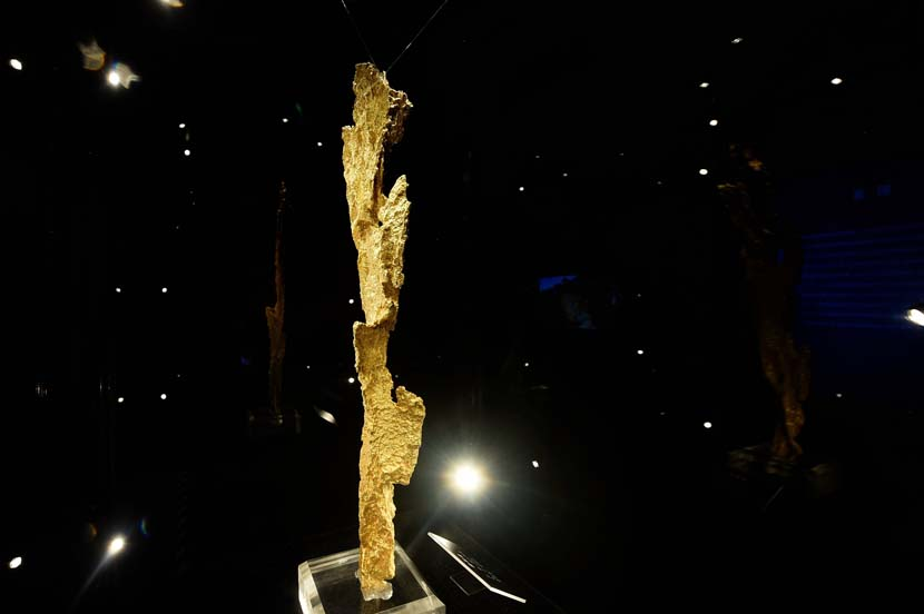 A natural gold formation measuring 20.4 inches long is exhibited in Hangzhou, Zhejiang province, June 25, 2019. The gold piece, nicknamed Thunder, was discovered in Australia and weighs 7.7 pounds. Long Wei/VCG