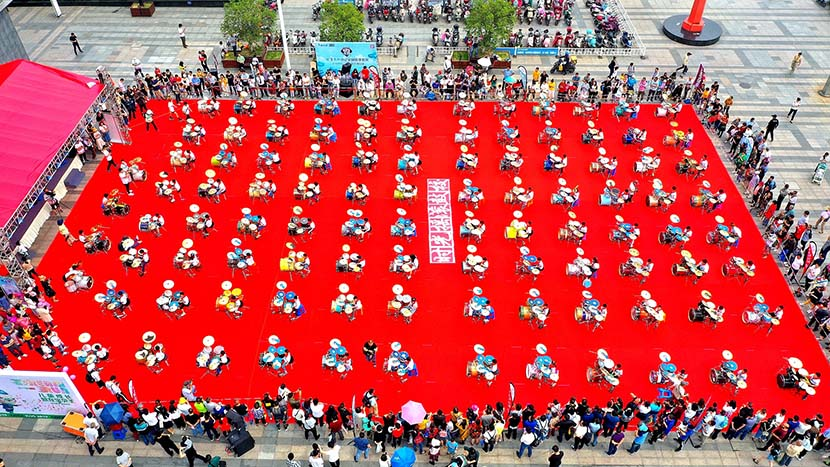 An aerial view of about 100 children playing drums to celebrate International Children's Day at the Wuxi Binhu Wanda Plaza, Wuxi, Jiangsu province, June 1, 2019. Yi Wei/VCG