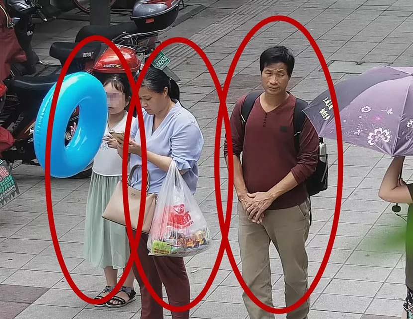 A screenshot taken from surveillance footage shows Zhang Zixin in front of a hotel along with the two suspected kidnappers in Xiangshan County, Ningbo, Zhejiang province, July 7, 2019. From The Paper