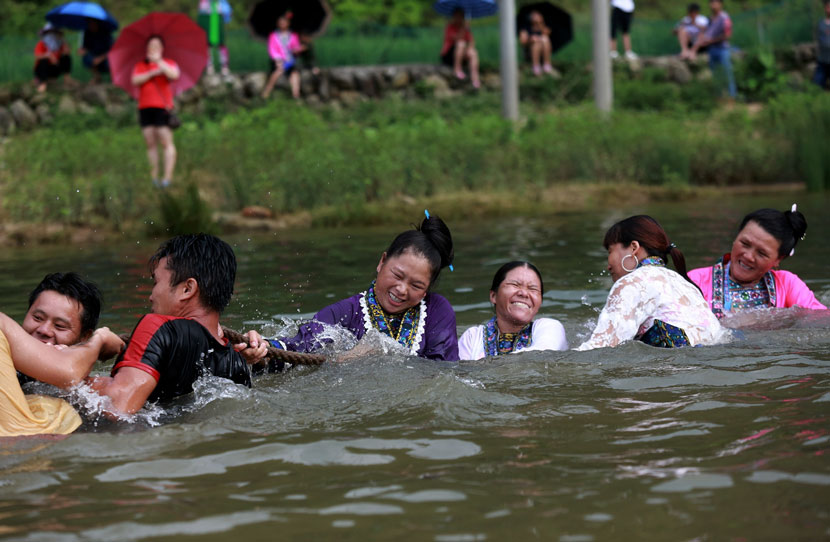 Local residents participate in a tug-of-war contest held in a river during the traditional Naoyu Festival in Liuzhou, Guangxi Zhuang Autonomous Region, July 18, 2019. Long Tao/IC