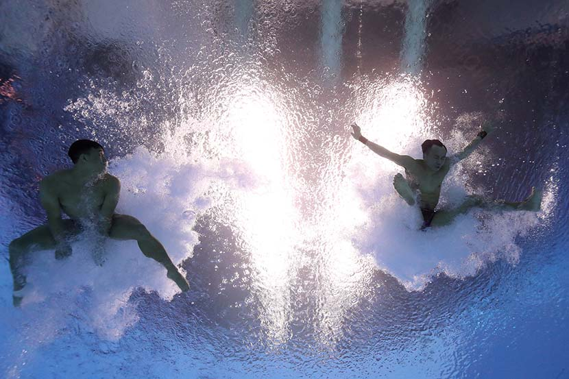 China's Yuan Cao and Siyi Xie compete in the men's 3-meter springboard synchro finals at the 18th FINA World Championships in Gwangju, South Korea, July 13, 2019. Quinn Rooney/Getty Images/VCG