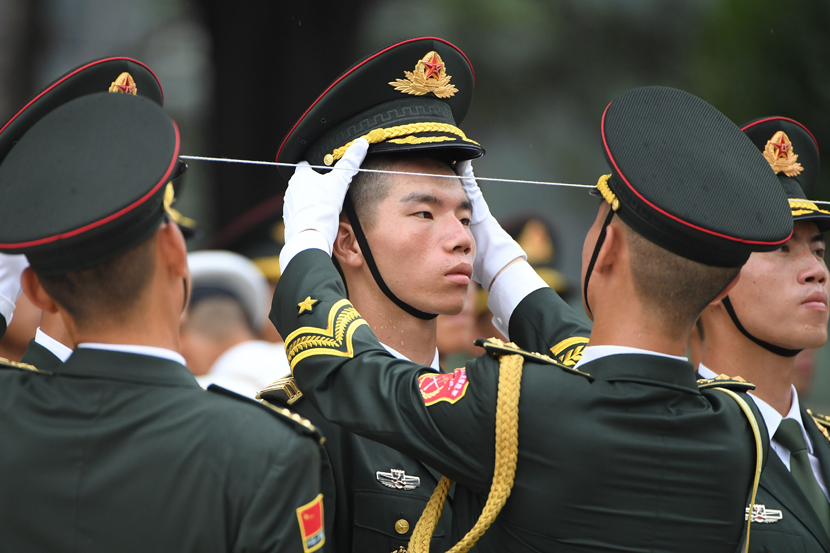 Members of the military honor guard prepare for the welcoming ceremony for Abu Dhabi Crown Prince Mohammed bin Zayed outside the Great Hall of the People in Beijing, July 22, 2019. Greg Baker/AFP/VCG