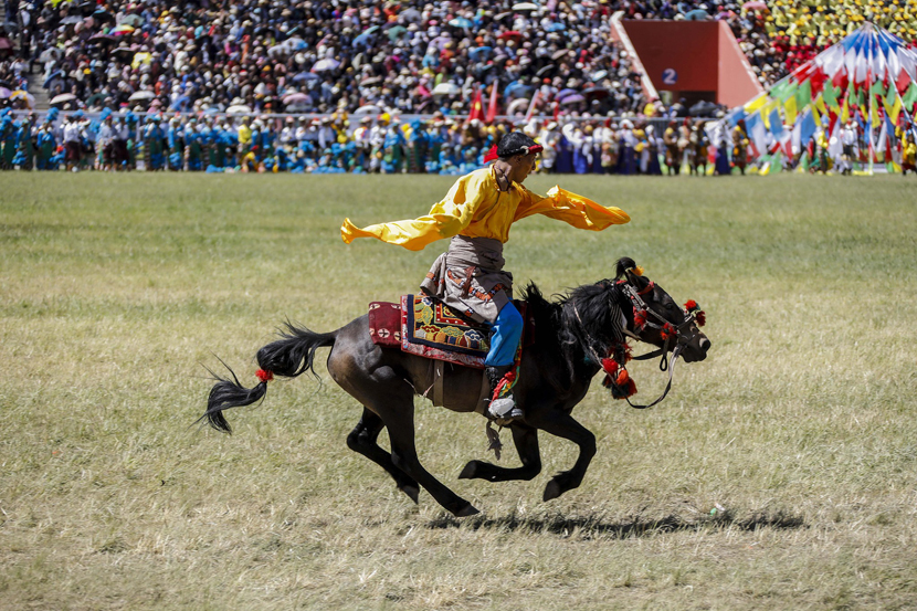 A man on horseback performs in the opening ceremony of Qinghai's annual Yushu Horse Racing Festival in Yushu Tibetan Autonomous Prefecture, Qinghai province, July 25, 2019. Han Jiajun/VCG