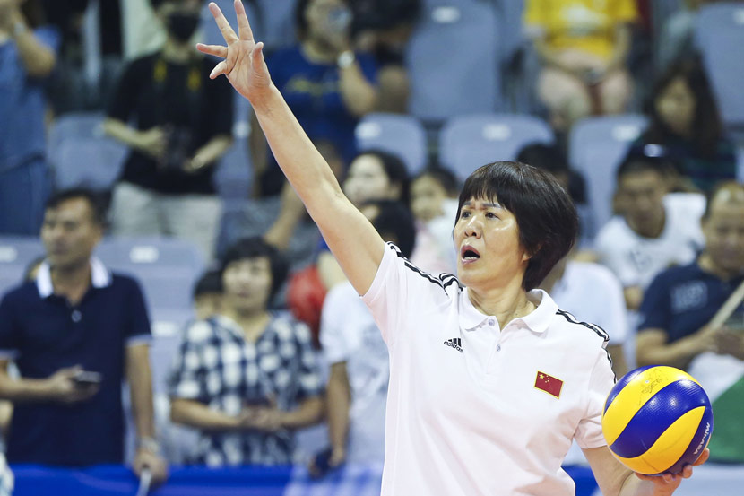 Lang Ping, the head coach of China's national women's volleyball team, reacts to a play during Olympic qualifiers in Ningbo, Zhejiang province, Aug. 3, 2019. VCG