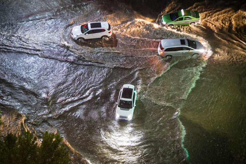 Cars ford a flooded street in Zhengzhou, Henan province, Aug. 1, 2019. Henan Business Daily/IC