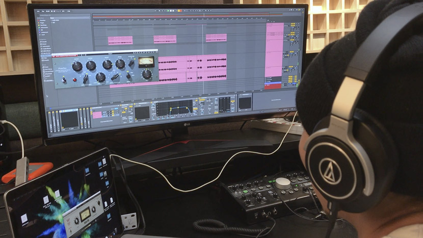 One of Yunmao's staff members adds audio samples to a melody in Beijing, May 2019. Tang Xiaolan/Sixth Tone