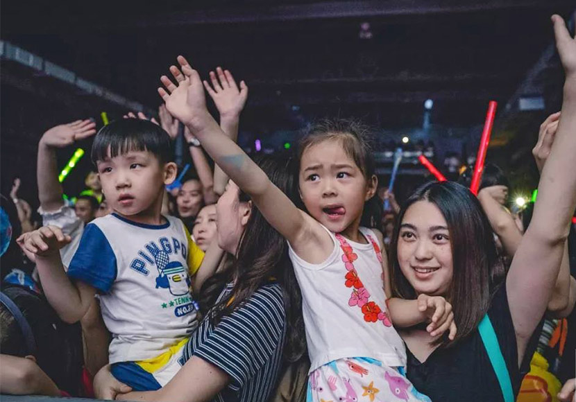 Children wave their hands during Hand in Hand's festival in Chengdu, Sichuan province, 2018. From Hand in Hand's WeChat account