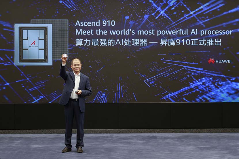 Eric Xu, Huawei's rotating chairman, shows off the Chinese telecom company's new AI chip, the Ascend 910, during a press conference in Shenzhen, Guangdong province, Aug. 23, 2019. Courtesy of Huawei