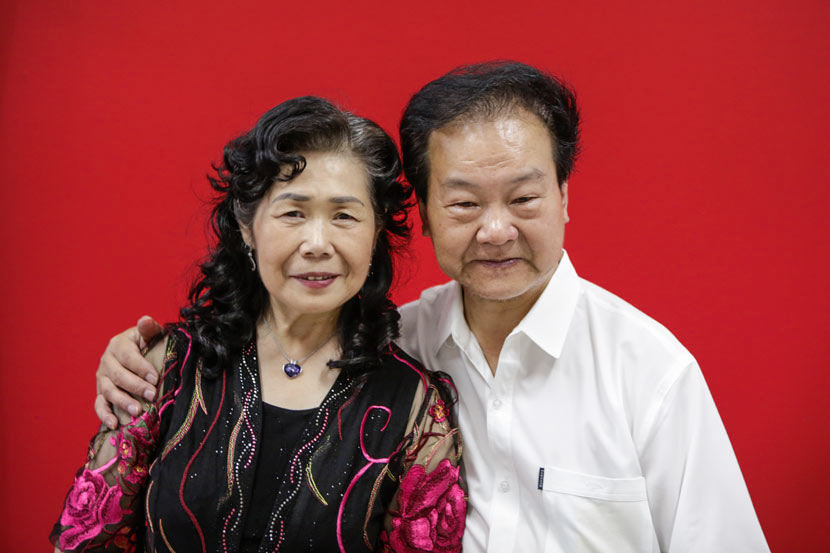 Dong Miaoxiang (right), 72, and Liang Jin'e, 67, pose for a wedding photo at the civil affairs bureau in Suzhou, Jiangsu province, June 1, 2017. Zhong Changqian/Sixth Tone