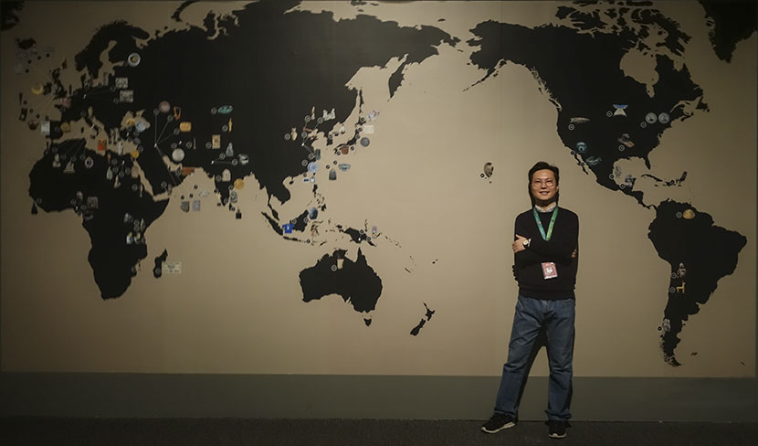 Yan Zhi poses for a photo at the 'A History of the World in 100 Objects' exhibition at the National Museum of China, Beijing, Feb. 28, 2017. Courtesy of Yan Zhi