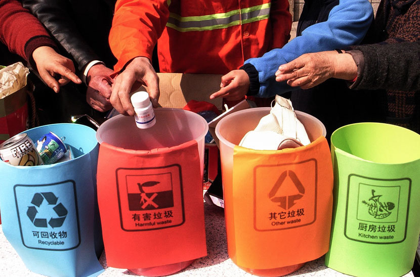 Color-coded bins are displayed at an event to promote trash sorting in Hangzhou, Zhejiang province, March 28, 2010. Wu Huang/VCG