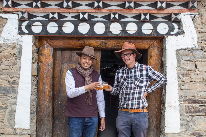 Norbu (left) and Maxim Nesazal pose for a photo at their craft beer brewery near Xinduqiao Town, Sichuan province, May 9, 2017. Zhou Pinglang/Sixth Tone