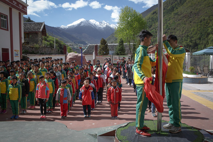 Students attend a flag-raising ceremony at the Garze Tibetan Autonomous Prefecture Special Education School in Yulin Township, Kangding, Sichuan province, May 8, 2017. Zhou Pinglang/Sixth Tone