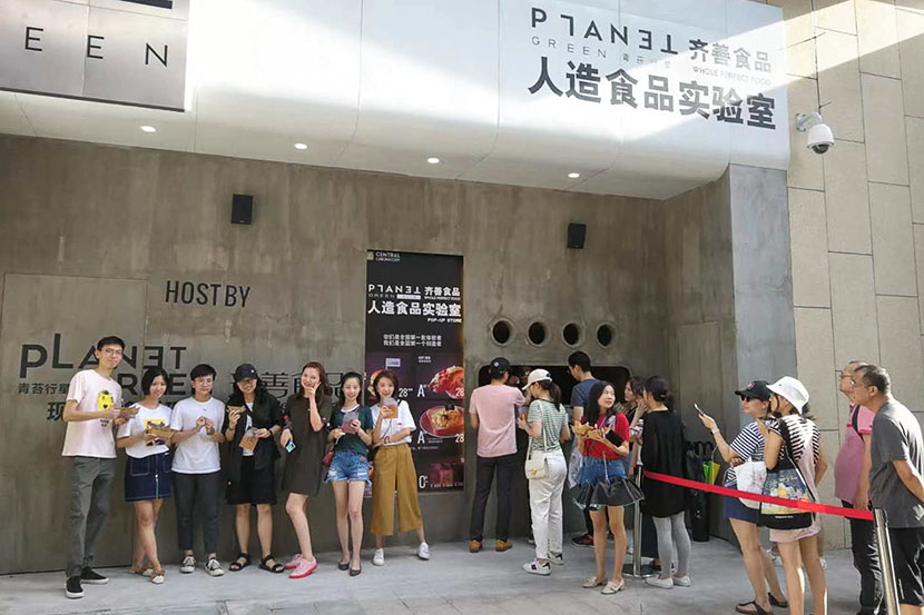 Customers wait in line outside of the Artificial Food Lab pop-up co-opened by Whole Perfect and Planet Green in Shenzhen, Guangdong province, June 19, 2019. Courtesy of Whole Perfect Food