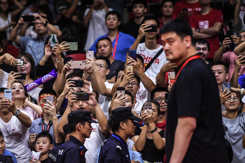 Fans snap photos of Yao Ming, former NBA player and current president of the Chinese Basketball Association, during a match between China and South Korea at the 2019 FIBA World Cup in Guangzhou, Guangdong province, Sept 6, 2019. Liu Jialiang/IC