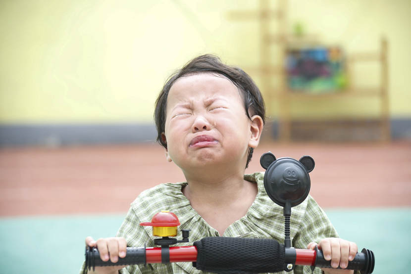 A girl cries on her first day of kindergarten in Huai'an, Jiangsu province, Sept. 2, 2019. Zhao Qirui/VCG