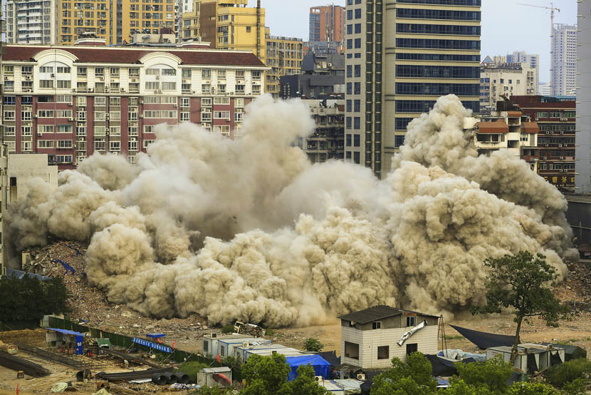 The Yida Building is demolished in a controlled explosion in Yichang, Hubei province, Sept. 5, 2019. Over 400 kilograms of explosives and nearly 2,500 detonators were used to bring down the 49.5-meter-tall building. Wen Zhenxiao/VCG