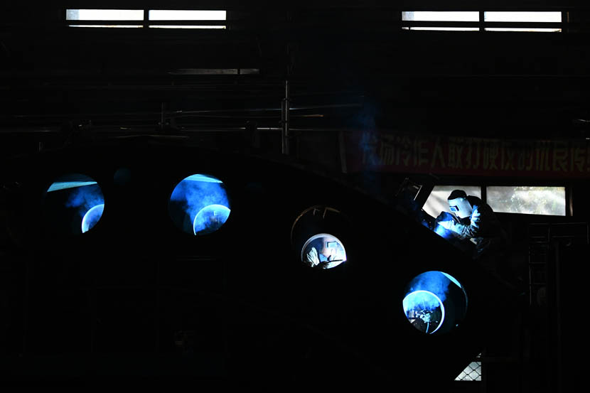 Welders at work in a Harbin Electric Machinery plant in Qiqihar, Heilongjiang province, Sept.2, 2019. Wang Jianwei/Xinhua