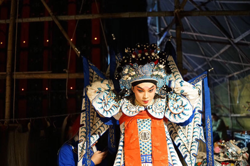 Yu Zefeng stands backstage before a Western Qin opera performance in Meilong Town, Haifeng County, Guangdong province, Jan. 10, 2019. Courtesy of Yu Zefeng