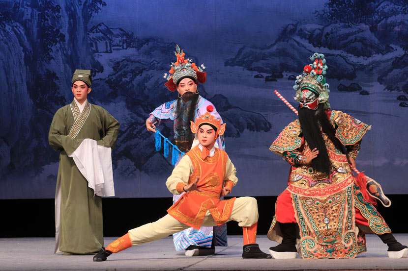Yu Zefeng (in orange) and Lü Weiping (in lavender) during a Western Qin opera performance at the Ma Sicong Arts Centre, Shanwei, Guangdong Province, Aug. 12, 2018. Courtesy of Yu Zefeng