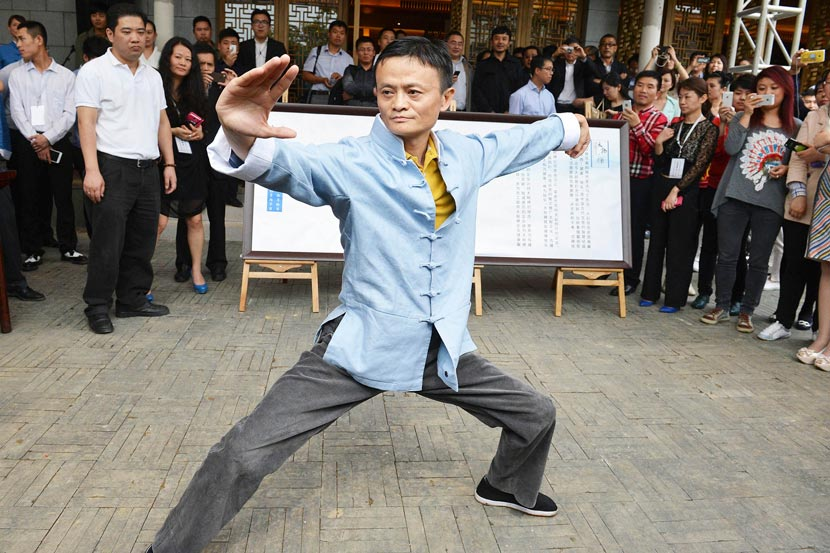 Jack Ma holds a martial arts pose during an event in Hangzhou, Zhejiang province, Sept. 16, 2018. VCG