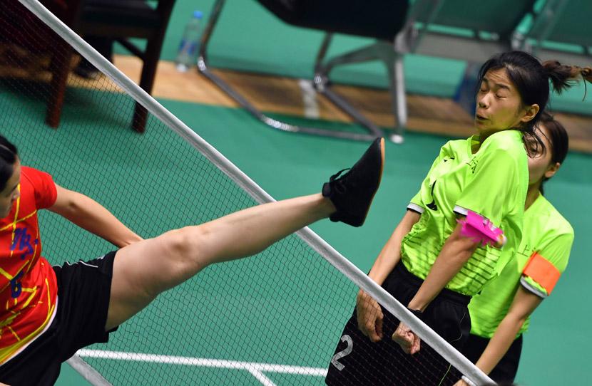 Players react during a match of shuttlecock kicking at the 11th National Games of Ethnic Minorities of the People's Republic of China, in Zhengzhou, Henan province, Sept. 9, 2019. Li Jianan/Xinhua