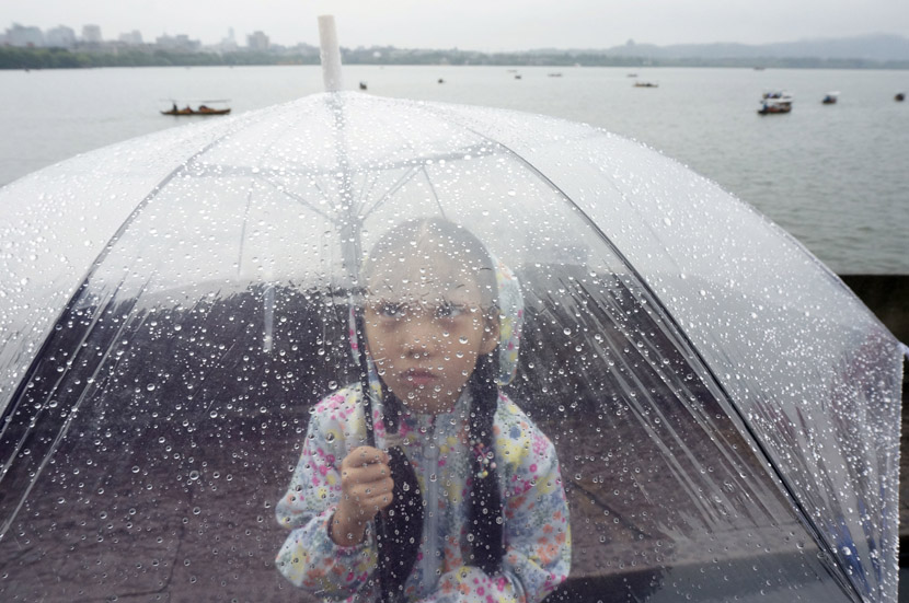 A girl holds an umbrella during a rainy day in Hangzhou, Zhejiang province, Aug. 29, 2019. Wu Huang/IC
