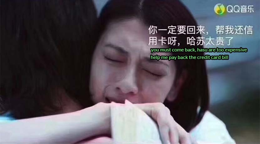 "A screenshot from the ""Won't Cry"" music video includes a netizen-added subtitle of the woman supposedly telling her boyfriend he'd better come back and help pay for the expensive Hasselblad camera she gifted him. From QQ Music"