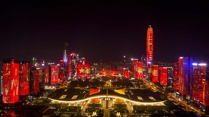 The city skyline turns red as part of a light show to mark the 70th anniversary of the founding of the People's Republic of China on Oct. 1, 1949, in Shenzhen, Guangdong province, Sept. 20, 2019. VCG