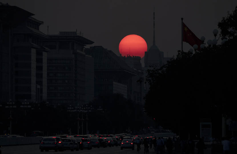 The sun sets on Beijing, Sept. 27, 2019. Noel Celis/ AFP/Getty Images/VCG