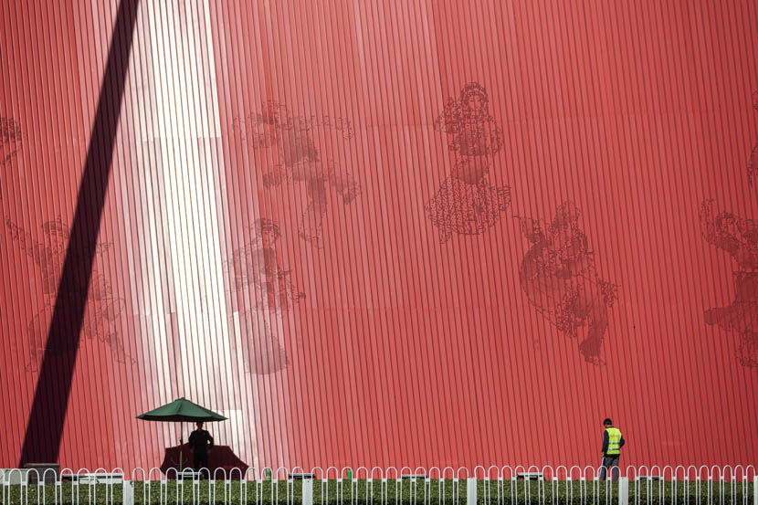 Ahead of the upcoming National Day holiday, a worker waters plants in front of a large installation at Tiananmen Square in Beijing, Sept. 24, 2019. Shen Qilai /Bloomberg via Getty Images/VCG