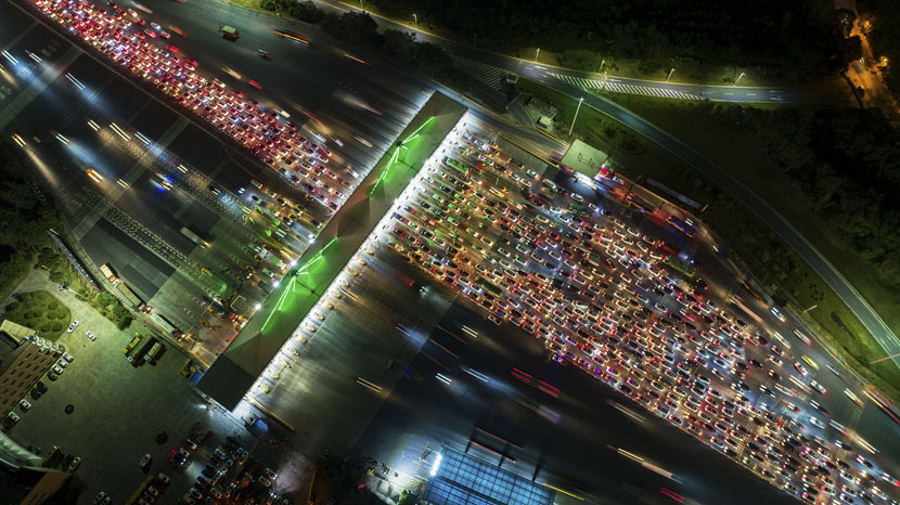 An aerial view shows a traffic jam near a toll station in Nanjing, Jiangsu province, Sept. 30, 2019. Costfoto/Barcroft Media/VCG