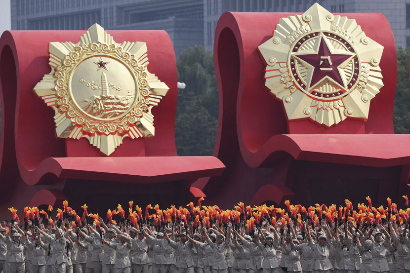 "Floats honoring the People's Liberation Army and the struggle for ""freedom and independence"" pass by Tiananmen Square during the National Day parade in Beijing, Oct. 1, 2019. Greg Baker/AFP/VCG"