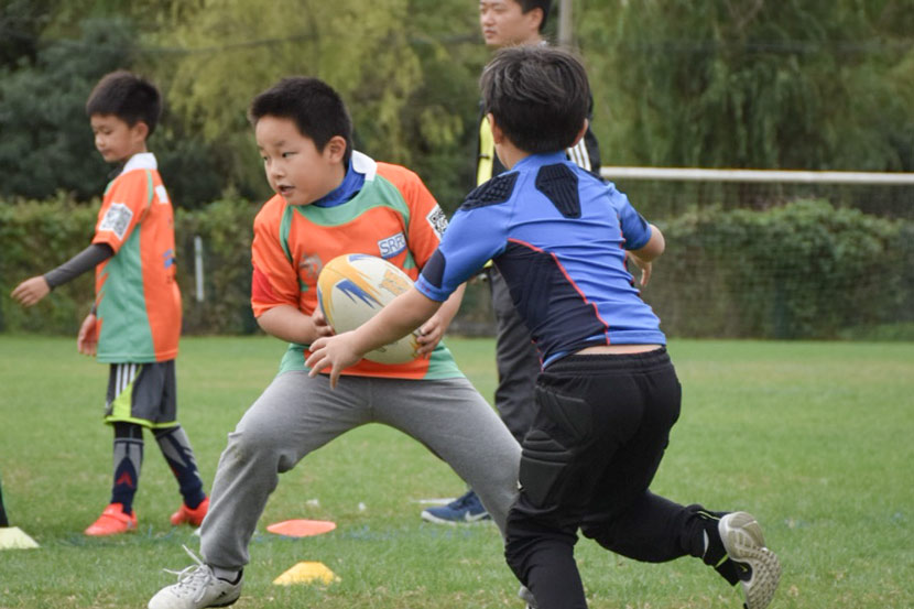 Children play rugby at the Shanghai Rugby Football Club in Shanghai, Oct. 20, 2018. Courtesy of Jin Qiaofan