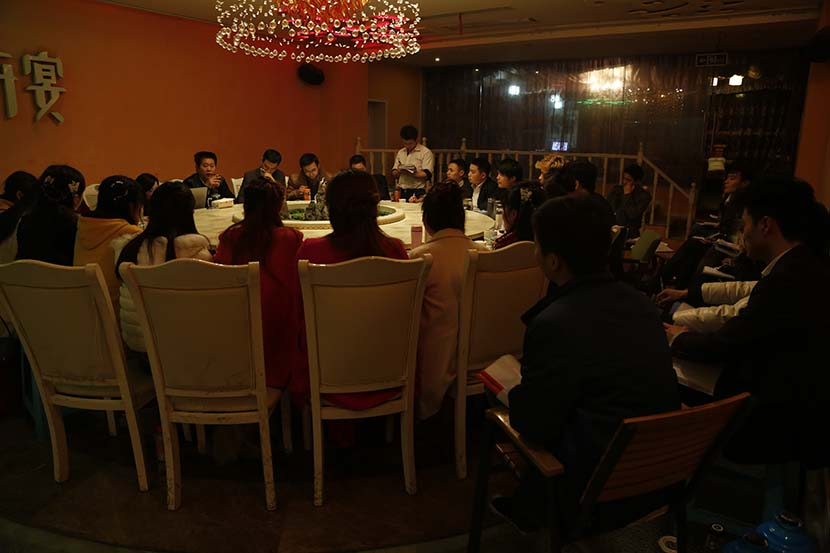 "A still from ""The Land of Peach Blossoms"" shows employees at a meeting. Courtesy of Zhou Mingying"