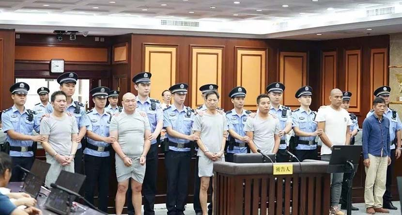 The six suspects stand trial for intentional homicide at the intermediate people's court in Nanning, Guangxi Zhuang Autonomous Region, Oct. 17, 2019. From the court's public WeChat account