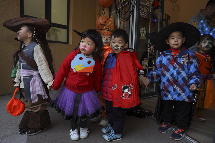 Children wear costumes for a Halloween party in Beijing, Oct. 31, 2019. Fred Lee/VCG