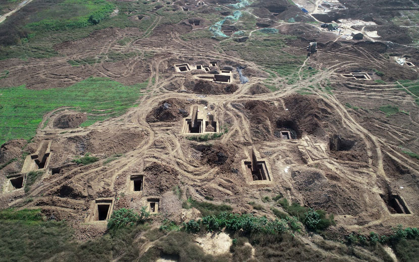 An aerial view of 136 tombs of the Chu State in the Eastern Zhou Dynasty at an archaeological evacuation site in Xiangyang, Hubei province, Oct, 30, 2019. Over 400 cultural relics, including bronze and jade ware, were found during the excavation. VCG