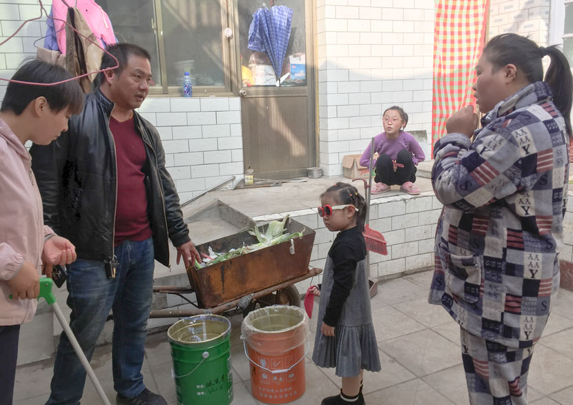 A family listens as a local official explains new garbage sorting rules in Wuyue Village, Hebei province, October 2019. Courtesy of the author