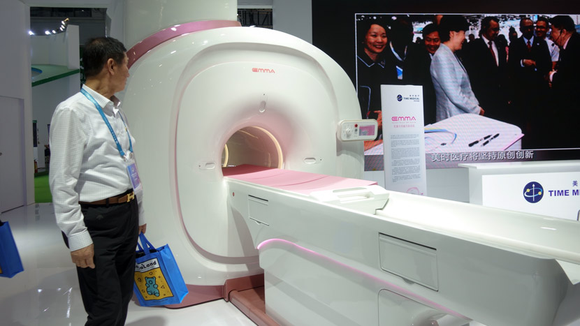 Time Medical shows an MRI machine designed specifically for breast cancer assessment at the 2nd China International Import Expo in Shanghai, Nov. 5, 2019. Sixth Tone